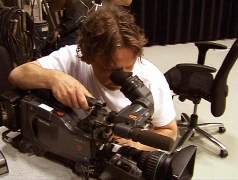 Cameraman Michaël setting up his camera