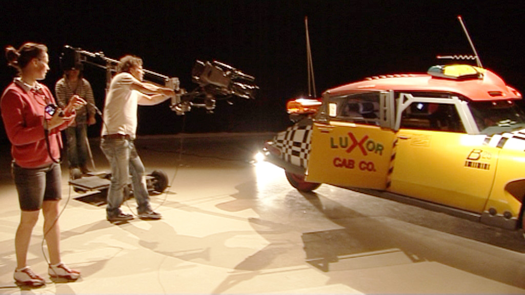 Producer Yvonne watches closely the interior filming of the Flying Taxi